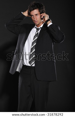 Young Businessman Talking on Phone - stock photo