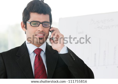 young businessman talking on the cell phone - stock photo
