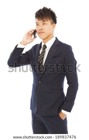 young businessman talking on the phone - stock photo