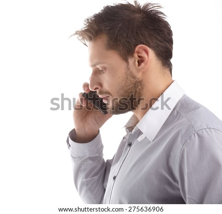 Young Businessman Talking over Cell Phone on Isolated White Background