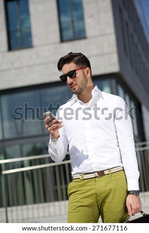 Young businessman talking to mobile - stock photo