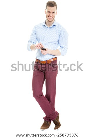 Young Businessman Texting on Cell Phone Isolated on White Background - stock photo