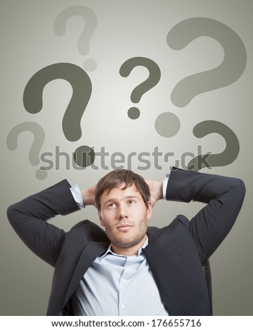 Young businessman thinking about a solution concept - stock photo