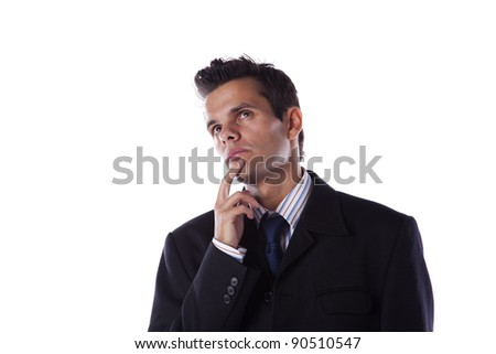 Young businessman thinking and looking up (isolated on white) - stock photo