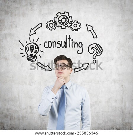 Young businessman thinking  consulting concept - stock photo