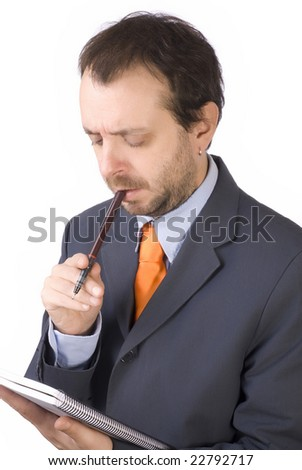 Young businessman thinking with a book and a pen in his hand