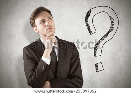 Young businessman thinking with hand on chin against white background