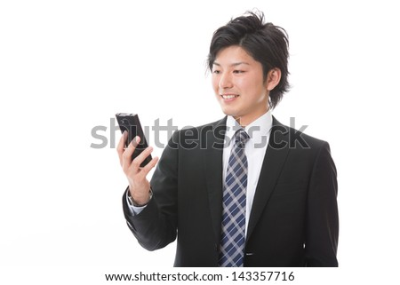 Young businessman to see a smart phone - stock photo