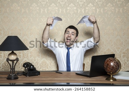 young businessman tore up the contract of employment - stock photo