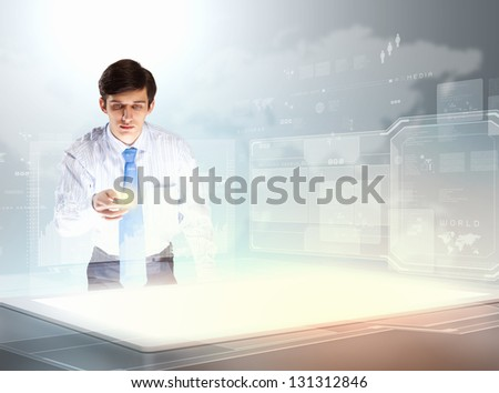 young businessman touching icon of high-tech image - stock photo