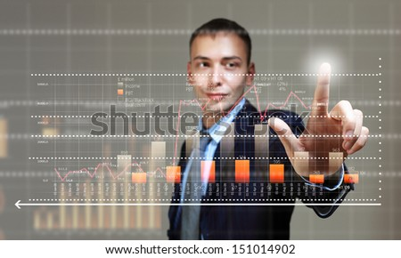 Young businessman touching icon of media screen with diagrams and graphs