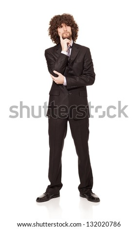 young businessman trying to make a decision isolated on white background - stock photo