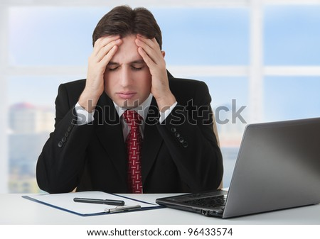 young businessman under stress, fatigue and headache, he kept his hands behind his head - stock photo