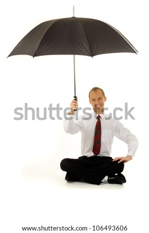 Young businessman under the umbrella - stock photo