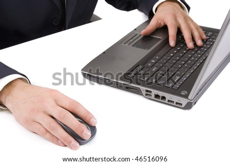 Young businessman using a laptop on white background - stock photo