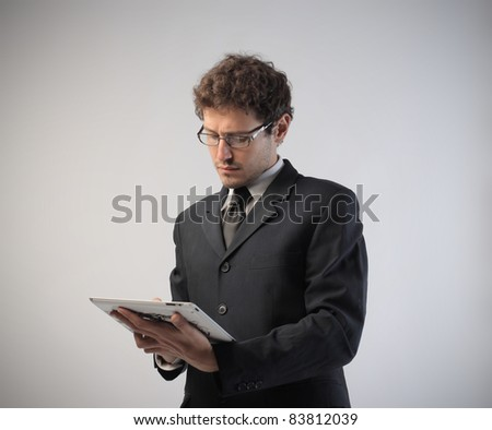 Young businessman using a tablet pc - stock photo