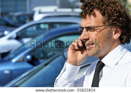 Young businessman using cellular phone - stock photo