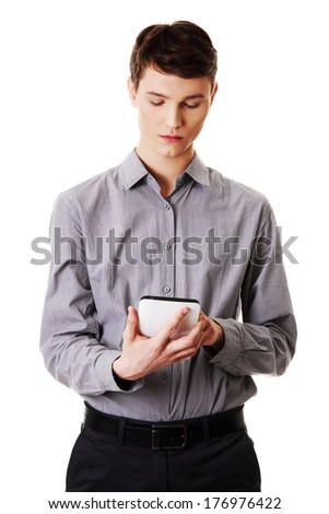 Young businessman using tablet computer , isolated