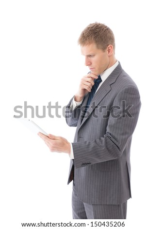 young businessman using tablet computer on white background - stock photo
