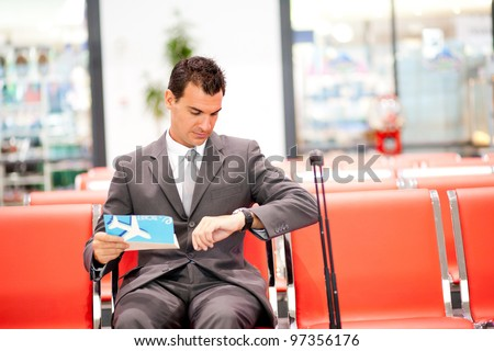 young businessman waiting his fight at airport - stock photo