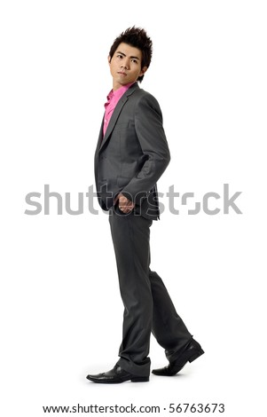 Young businessman walking and watching, full length portrait isolated on white background. - stock photo