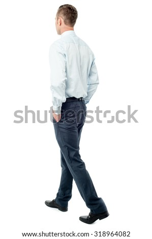 Young businessman walking away from camera - stock photo