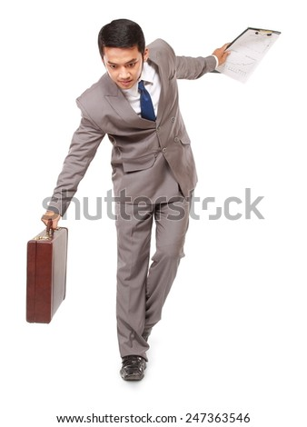 Young businessman walking maintain balance, isolated on white background - stock photo
