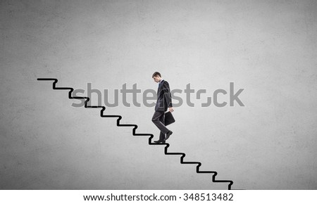 Young businessman walking up on ladder representing success concept