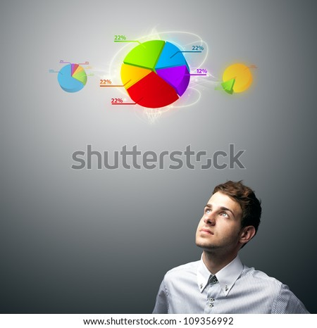 Young businessman watching virtual business sign, copyspace - stock photo