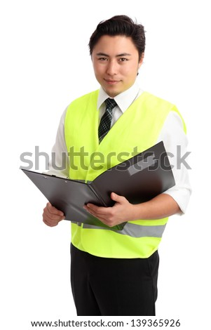 Young businessman wearing a reflective vest, holding a folder. White background.