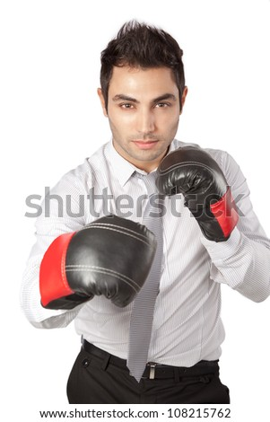 Young businessman  wearing boxing gloves isolated on white background. - stock photo