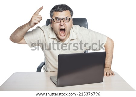 Young businessman wearing glasses angry shouts and shakes his finger. - stock photo