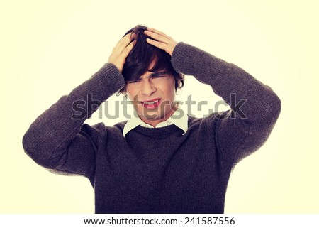 Young businessman with a big headache or problem. - stock photo