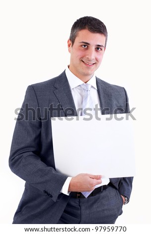 Young businessman with a blank sign