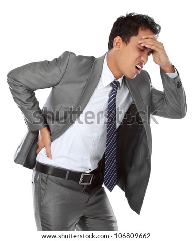 Young businessman with a headache against white background