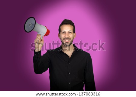 Young businessman with a Megaphone proclaiming something on purple background - stock photo