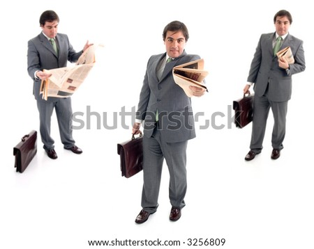 young businessman with a suitcase and a newspaper - stock photo