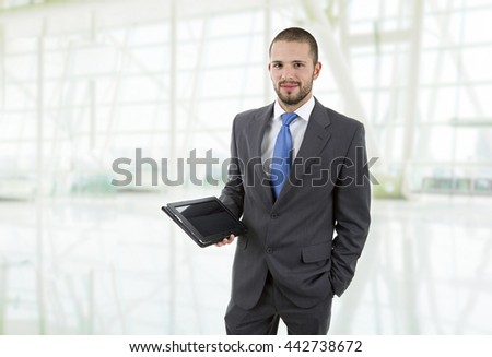 young businessman with a tablet pc, at the office