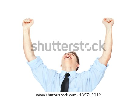 Young businessman with arms outstretched celebrating success isolated on white background