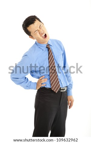 Young businessman with  back pain and isolated on white background - stock photo