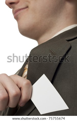Young businessman with blank card - stock photo