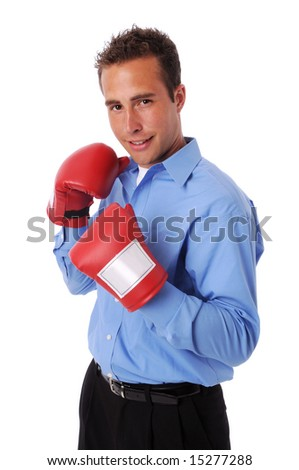 Young businessman with boxing gloves - stock photo