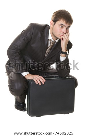 young businessman with briefcase thinking about their problems is isolated on a white - stock photo