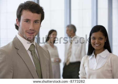 Young businessman with colleagues - stock photo