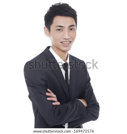 young businessman with crossed arms on white background