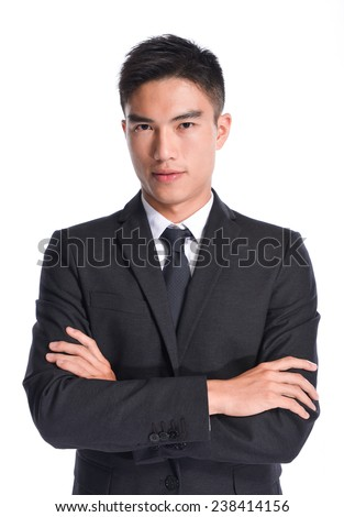 young businessman with crossed arms over white background - stock photo