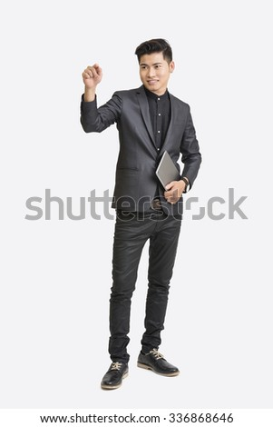 Young businessman with digital tablet and working on touch screen. - stock photo