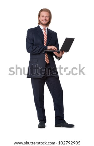 Young businessman with digital tablet showing on screen