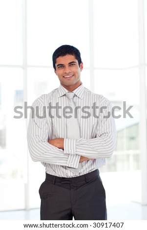 Young businessman with folded arms - stock photo