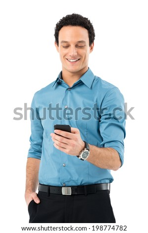Young Businessman With Hand In Pocket Using Cell Phone Isolated On White Background - stock photo